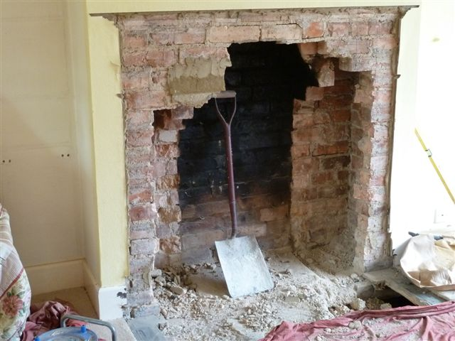 A photo sequence showing a fireplace being opened up and re-built with stove and beam