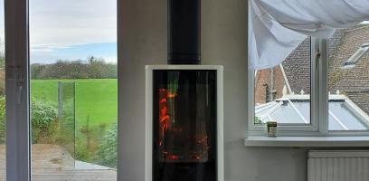 White Contura 870 wood burning stove installed and alight